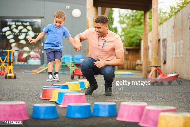 pre-school stepping stones - preschool child stock pictures, royalty-free photos & images