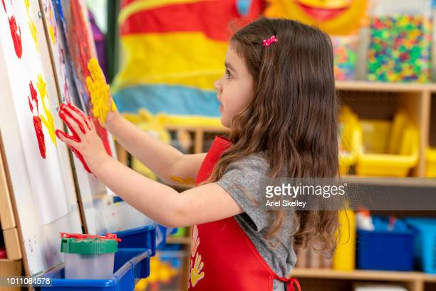 Pre-school Student Finger Painting