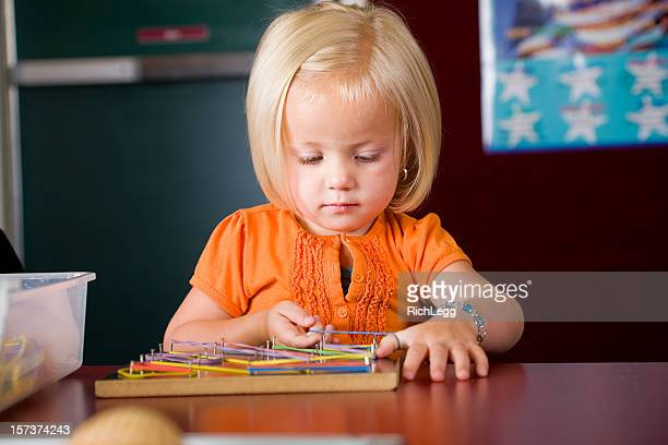 preschool student in a classroom - rich_legg stock photos and pictures