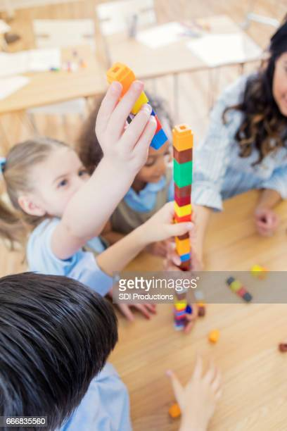 Preschool student uses counting blocks at school