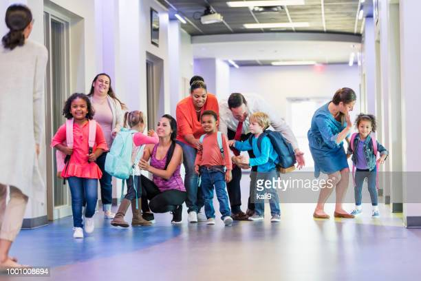 preschool students and parents, first day of school - genitori foto e immagini stock