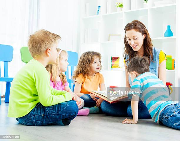 Preschool: Teacher Telling A Story to children.