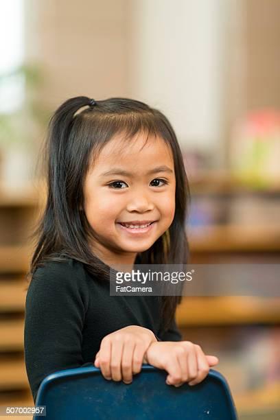 Criança Pré-escolar em sala de aula