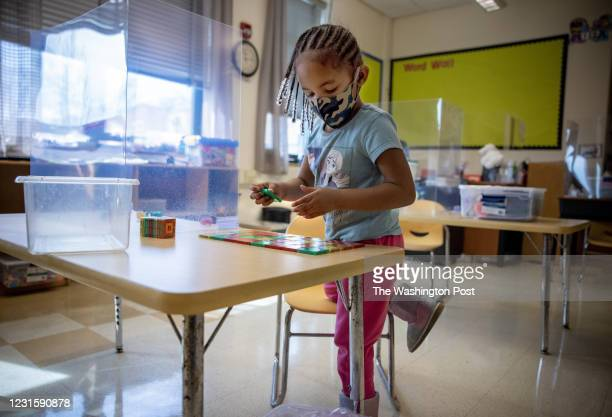 Preschooler Korey Hill works on an alphabet puzzle at Patterson Elementary School in Southwest, Washington, DC, February 26, 2021. Photo by Evelyn...