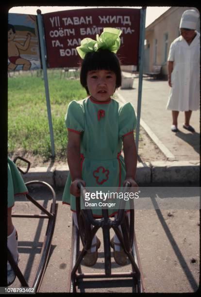 Preschooler Playing on Rocking Horse Mongolia