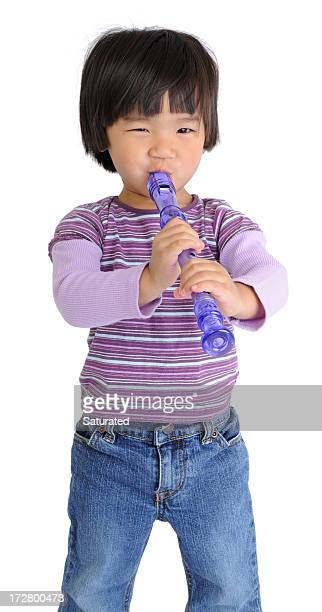 preschooler trying to play musical instrument (isolated on white) - recorder musical instrument stock photos and pictures