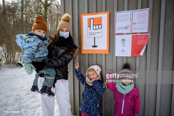 "Preschoolers and their teacher Eve pose next to a placard reading in French: ""Today we vote at the nursery"" on January 18, 2021 in Lausanne during a..."