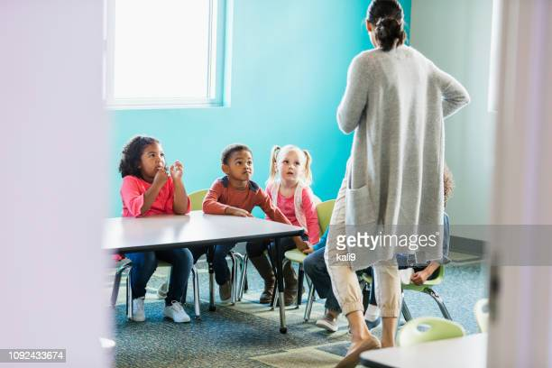 preschoolers looking at teacher with worried expressions - punishment stock pictures, royalty-free photos & images
