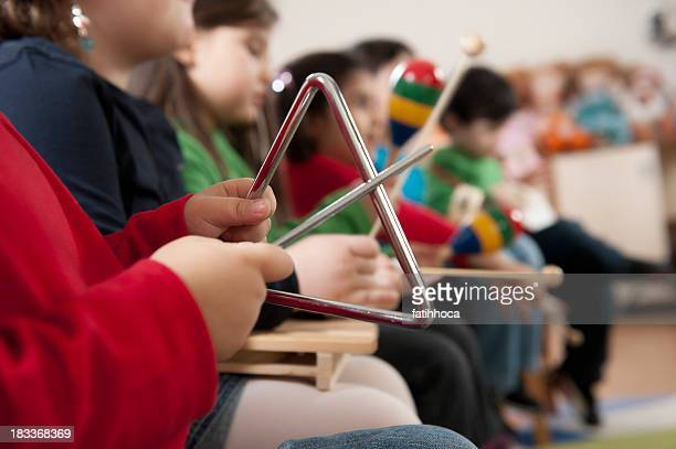 preschoolers - triangle percussion instrument stock photos and pictures