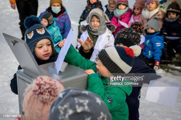Preschoolers place their vote in the ballot box on January 18, 2021 in Lausanne during a referendum, organized by private preschools network...