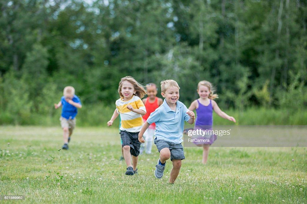 Preschoolers Playing Outside : Stock Photo