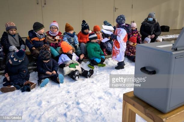 Preschoolers sit next to the ballot box on January 18, 2021 in Lausanne during a referendum, organized by private preschools network Educalis, aimed...