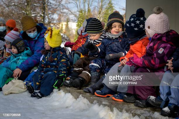 Preschoolers sit on January 18, 2021 in Lausanne during a referendum, organized by private preschools network Educalis, aimed to ease young children...