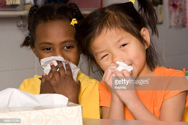 Preschoolers wiping their noses