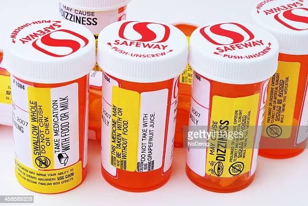 Prescription pill bottles with warning and information labels.