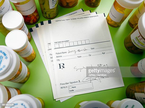 Prescription slip and pill bottles