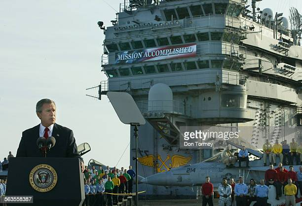 Presdient George W. Bush, delivers an inspirational speech to the sailors and the nation, on the flightdeck of the aircraft carrier USS Abraham...