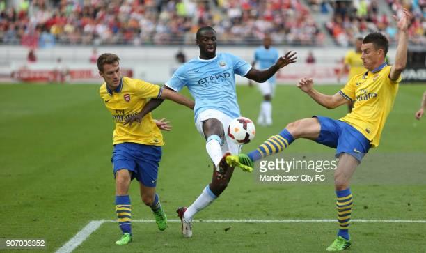 PreSeason Friendly Helsinki Arsenal v Manchester City Olympic Stadium Manchester City's Yaya Toure battles for the ball with Arsenal's Aaron Ramsey...