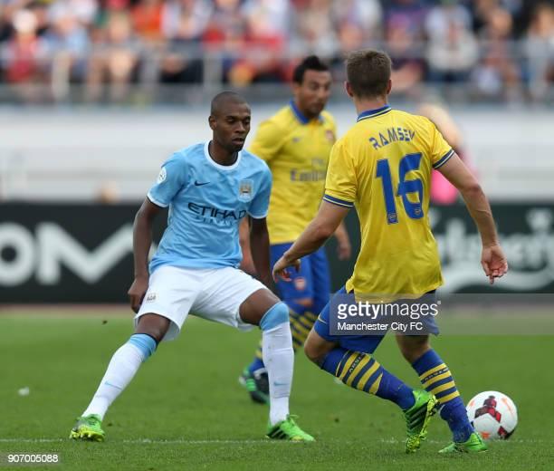 PreSeason Friendly Helsinki Arsenal v Manchester City Olympic Stadium Arsenal's Aaron Ramsey and Manchester City's Fernandinho battle for the ball