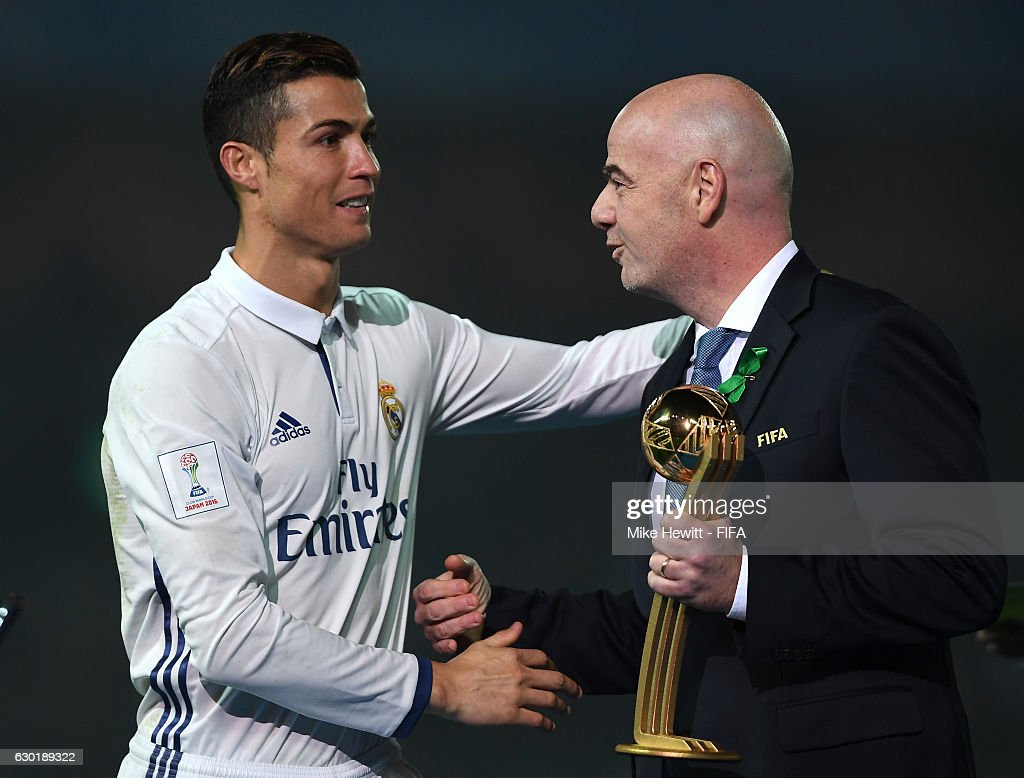 FIFA presedent, Gianni Infantino hands Cristiano Ronaldo of Real Madrid the Golden Boot trophy during the FIFA Club World Cup Final match between Real Madrid and Kashima Antlers at International Stadium Yokohama on December 18, 2016 in Yokohama, Japan.