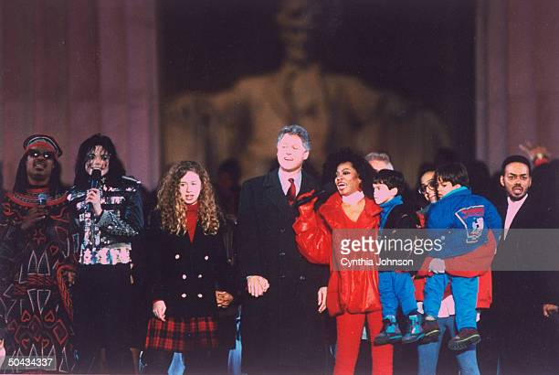 Preselect Bill Clinton holding hands w daughter Chelsea flanked by stars incl Stevie Wonder Michael Jackson Diana Ross during Inauguralwk fete at...