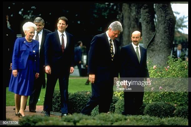 Preselect Bill Clinton walking w Mexican Pres Salinas de Gortari w VPelect Al Gore Gov Ann Richards et al in tow during mtg at Gov's mansion