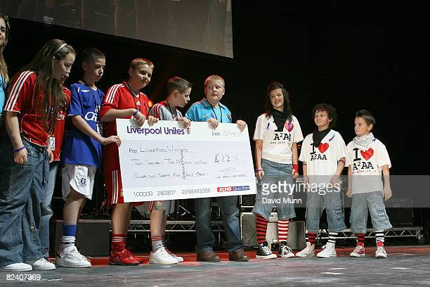 A2AA present a cheque to Rhys Jones School at Liverpool Unites Concert For Rhys at Echo Arena on August 15 2008 in Liverpool England