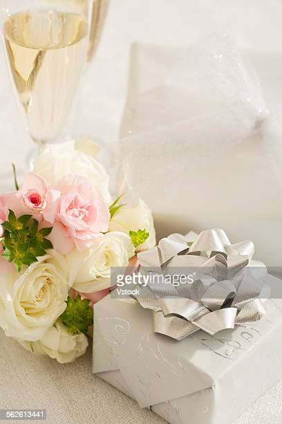Present and rose bouquet