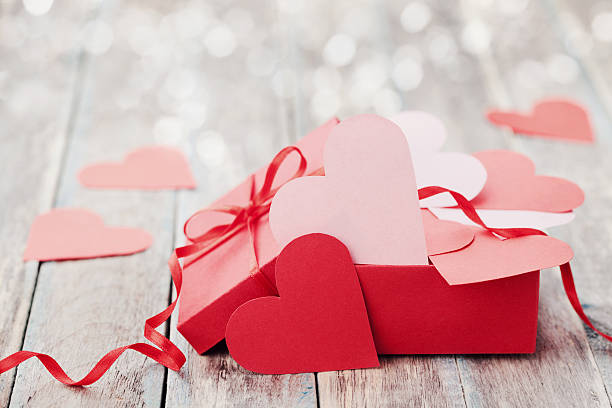 Present or gift box full of paper hearts, love concept