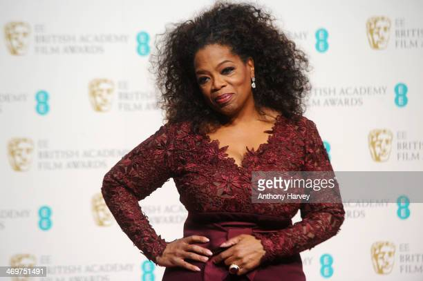 Presentater Oprah Winfrey poses in the winners room at the EE British Academy Film Awards 2014 at The Royal Opera House on February 16 2014 in London...
