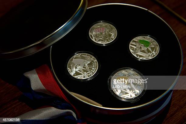 A presentation case of unique minted coins are displayed before being presented to British cyclist and winner of the 2013 Tour de France Chris Froome...