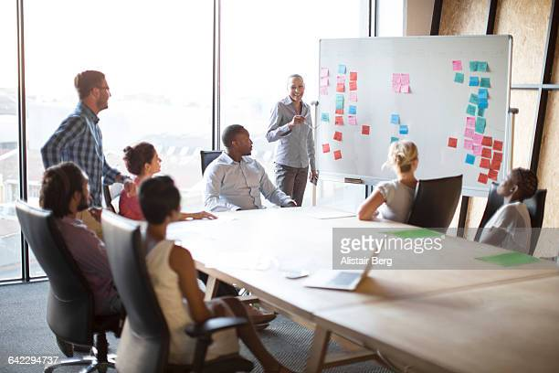 presentation in a conference room - business strategy stock pictures, royalty-free photos & images