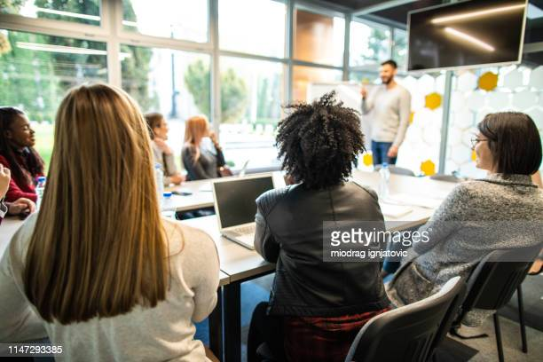 presentation of new business plan - economist stock pictures, royalty-free photos & images
