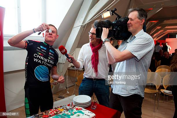 Presentation Tour of Denmark 2012 Rasmus Guldhammer Team Christina Watches Onfone eating cake for TV2Sporten ©Lars Rønbøg / Frontzonesport