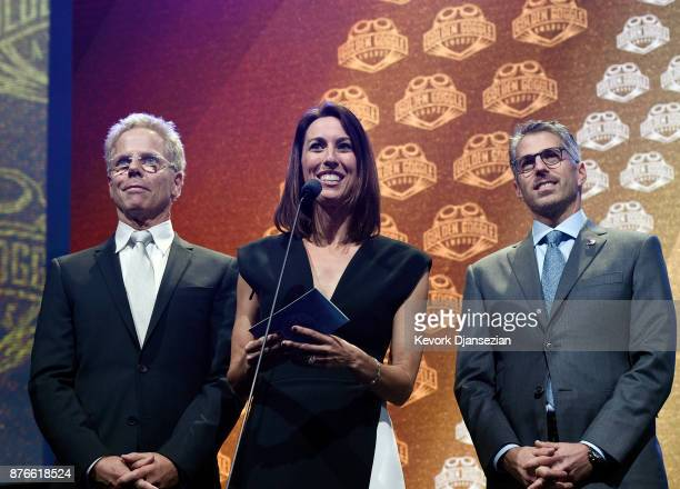 Presenter actor Greg Germann Janet Evans and Casey Wasserman present the Golden Goggle Award for Male Race of the Year to Lilly King during the 2017...