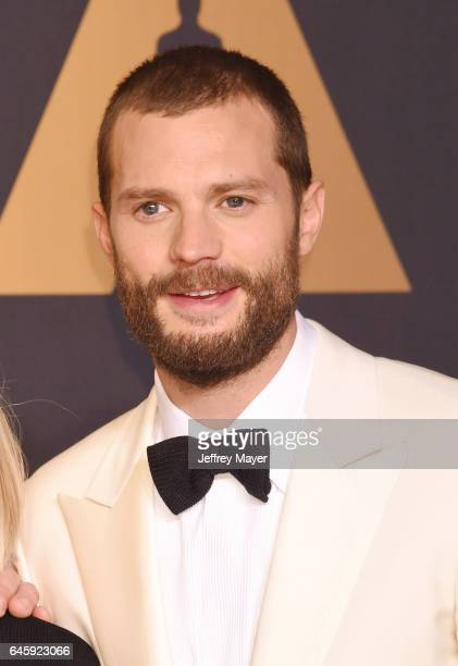 Presenter actor Jamie Dornan poses in the press room during the 89th Annual Academy Awards at Hollywood Highland Center on February 26 2017 in...