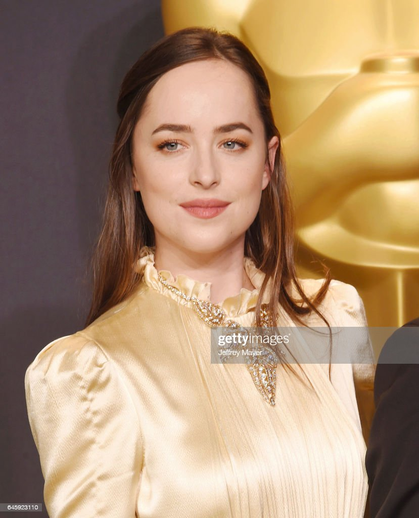 Presenter actress Dakota Johnson poses in the press room during the 89th Annual Academy Awards at Hollywood & Highland Center on February 26, 2017 in Hollywood, California.
