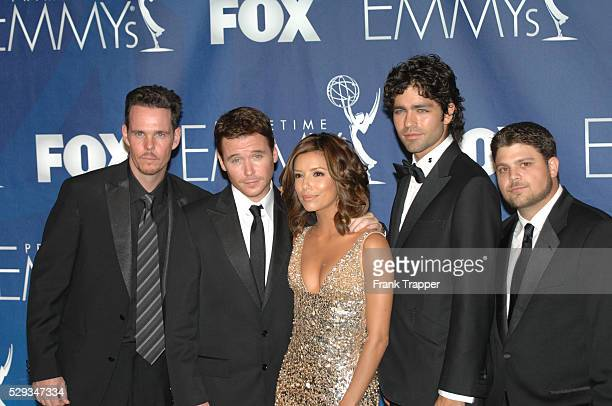 Presenter actress Eva Longoria poses with Entourage cast members Kevin Dillon Kevin Connolly Adrian Grenier and Jerry Ferrara in the press room at...