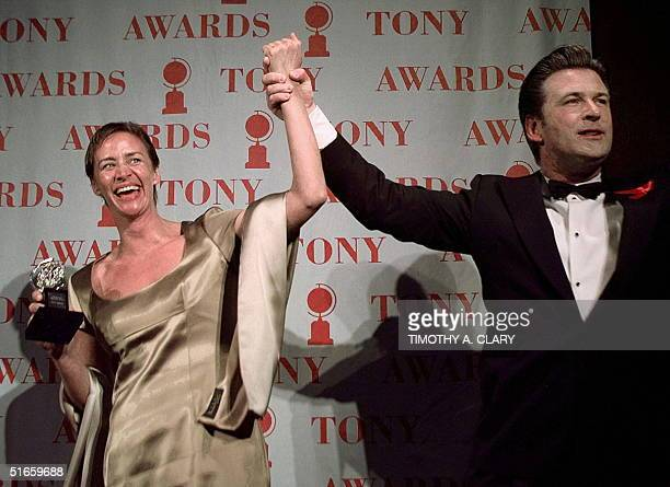 Presenter Alec Baldwin holds up the arm of 1997 Tony Award winner for Best Leading Actress in a Play Janet McTeer after she won for her role in A...