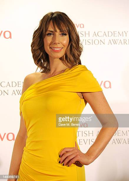 Presenter Alex Jones poses in front of the winners boards at the Arqiva British Academy Television Awards 2012 held at Royal Festival Hall on May 27...
