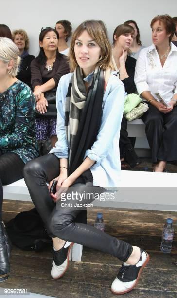 Presenter Alexa Chung smiles during the Margaret Howell Fashion show London Fashion Week Spring / Summer 2010 at the Margaret Howell Store on...