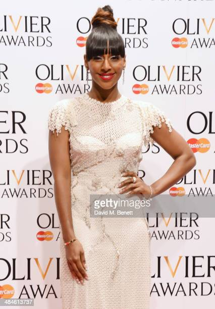 Presenter Alexandra Burke poses in the press room at the Laurence Olivier Awards at The Royal Opera House on April 13, 2014 in London, England.