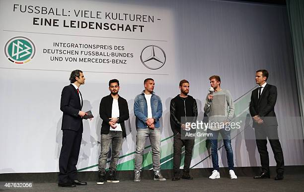 Presenter Ali Aslan Ilkay Guendogan Lukas Podolski Shkodran Mustafi Christoph Kramer and Oliver Bierhoff attend the DFB Mercedes Benz Integration...