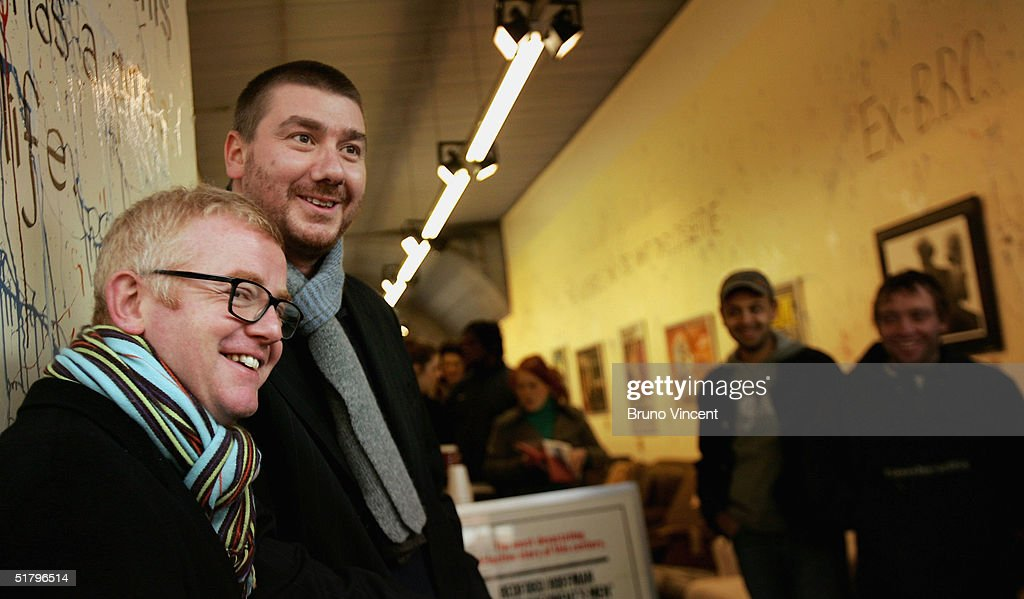 TV presenter and business entrepreneur Chris Evans and his buisness partner Pete Winterbottom pose at Camden Stables Market on November 27, 2004 in London. Evans is to sell off furniture and a Jaguar car, which have been in storage following the sales of several of his properties, at the popular London market.