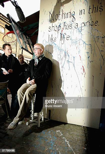 TV presenter and business entrepreneur Chris Evans sells his wares at Camden Stables Market on November 27 2004 in London England He is selling off...