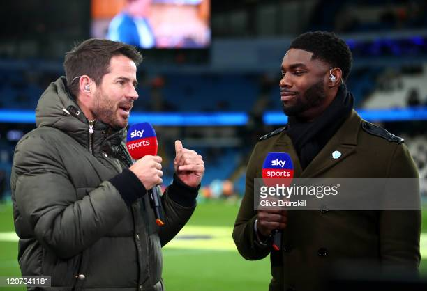 Presenter and former footballer Jamie Redknapp talks to former Manchester City player Micah Richards prior to the Premier League match between...