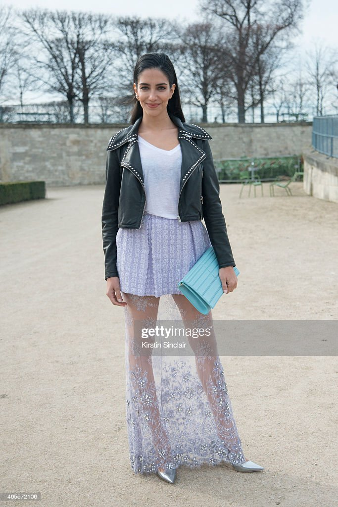 TV presenter and former Miss Australia Jessica Kahawaty wears Madiyah Al Sharqi jacket, top and skirt, Dior shoes, Elie Saab bag on day 5 of Paris Collections: Women on March 07, 2015 in Paris, France.