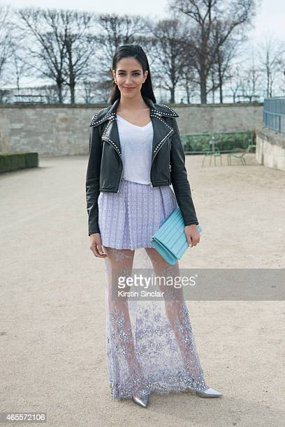 TV presenter and former Miss Australia Jessica Kahawaty wears Madiyah Al Sharqi jacket top and skirt Dior shoes Elie Saab bag on day 5 of Paris...