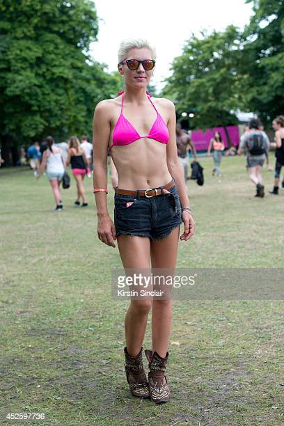 Presenter and Model Danni Menzies wearing Brick Lane market sunglasses Primark bikini H and M shorts and Jeffrey Campbell boots at Lovebox 2014 on...
