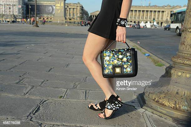 Presenter and prouducer Hofit Golan wears an Emanuel Ungaro bag and bracelet and a Guy Laroche shorts on day 3 of Paris Collections Women on...
